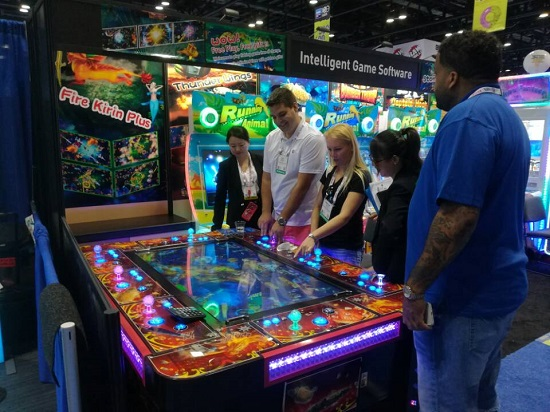 Iaapa attractions expo fish hunting game machine arcade for How to play fish table game