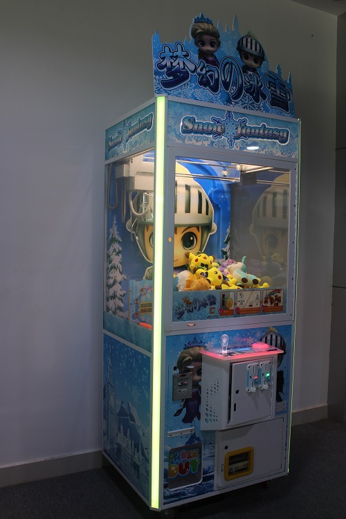 Intelligent Game crane machine viewed from the side